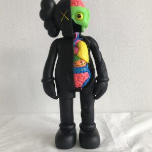 Kaws Small Lie black 2008 painted vinyl sculpture cm35x15x10 front