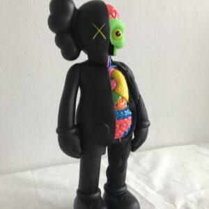 Kaws Small Lie black 2008 painted vinyl sculpture cm35x15x10 right